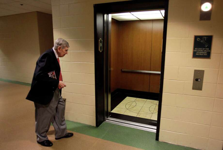 After arriving to Minute Maid Park, Milo Hamilton enters the elevator to go to his radio booth where he will call the Houston Astros and St. Louis Cardinals game as his last home game as the radio voice of the Astros. Photo: Melissa Phillip, Houston Chronicle / © 2012 Houston Chronicle