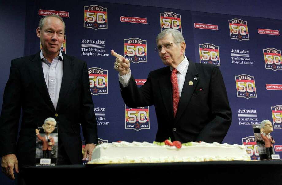 Astros owner Jim Crane and Milo Hamilton prepare to pose for a photo with Milo's cake after a media conference before the Houston Astros and St. Louis Cardinals game. Photo: Melissa Phillip, Houston Chronicle / © 2012 Houston Chronicle