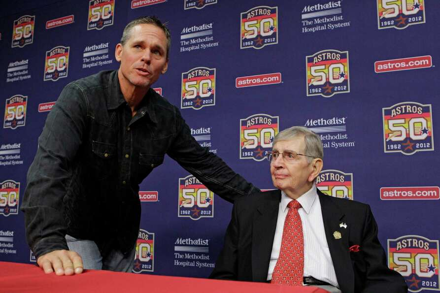 Former Astros Craig Biggio visits with Milo Hamilton after a media conference before the Houston Ast