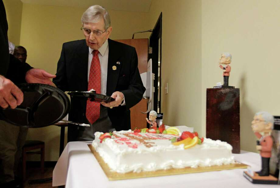 Milo Hamilton cuts and passes out pieces of his cake in the media dining room before the Houston Astros and St. Louis Cardinals game that will his last home game as the radio voice of the Astros. Photo: Melissa Phillip, Houston Chronicle / © 2012 Houston Chronicle