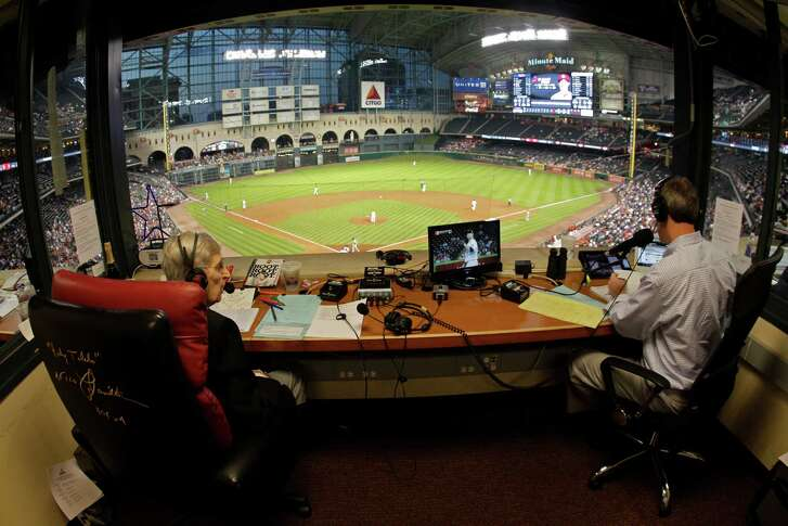 Milo Hamilton, left, and Dave Raymond, right, in the radio booth as Milo calls the Houston Astros and St. Louis Cardinals game that will his last home game as the radio voice of the Astros.