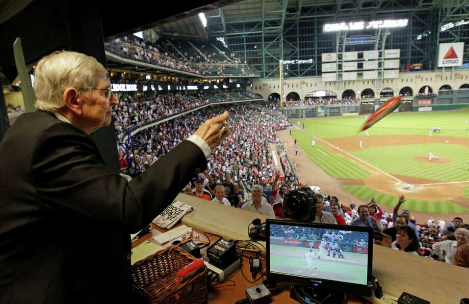 Milo Hamilton tosses bags of peanuts to the crowd from the radio booth in the 7th inning as he calls the Houston Astros and St. Louis Cardinals game. Photo: Melissa Phillip, Houston Chronicle / © 2012 Houston Chronicle