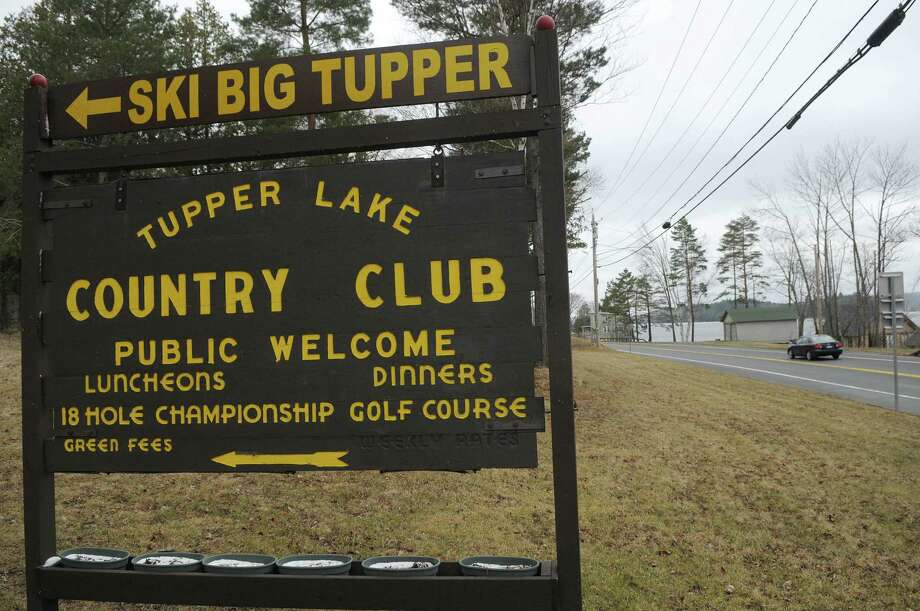 A sign off Route 30 points the way to the Big Tupper sik hill on Thursday March 29, 2012 in Tupper Lake, NY.    Because of a lack of snow this ski season there were only 12 days of skiing at the ski hill this season.  The ski hill is now shut for the season.  (Paul Buckowski / Times Union) Photo: Paul Buckowski / 00017012A