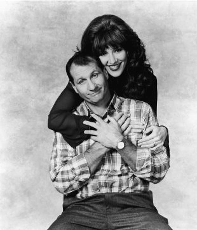 "Ed O'Neill was best known as Al Bundy on ""Married ... with Children"" before he joined ""Modern Family."" He's pictured in 1993 with actress Katey Sagal, who played Peggy Bundy. (Getty Images)"