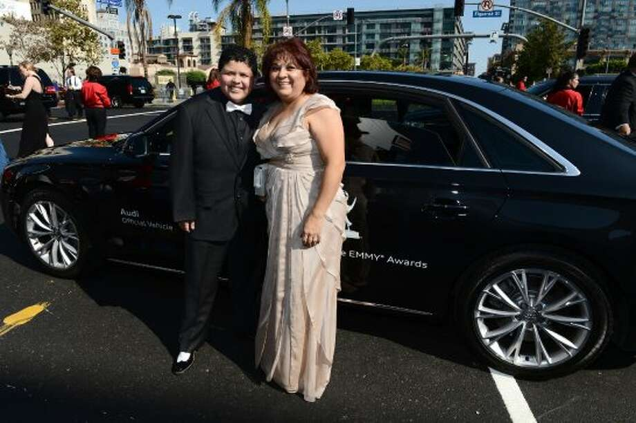 Rico Rodriguez (L) and mom Diane Rodriguez at the Emmy awards on Sept. 23, 2012. He has said he began acting when he was about 8, when his sister started acting.  (Michael Buckner / Getty Images for Audi)