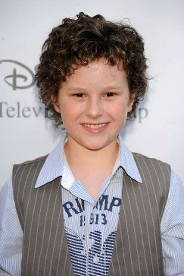 Nolan Gould, 13, began acting in commercials when he was 3. Known for playing dim-witted Luke Murphy, Gould is a smart kid - he's a member of Mensa. He's pictured in 2009.  (Frazer Harrison / Getty Images)