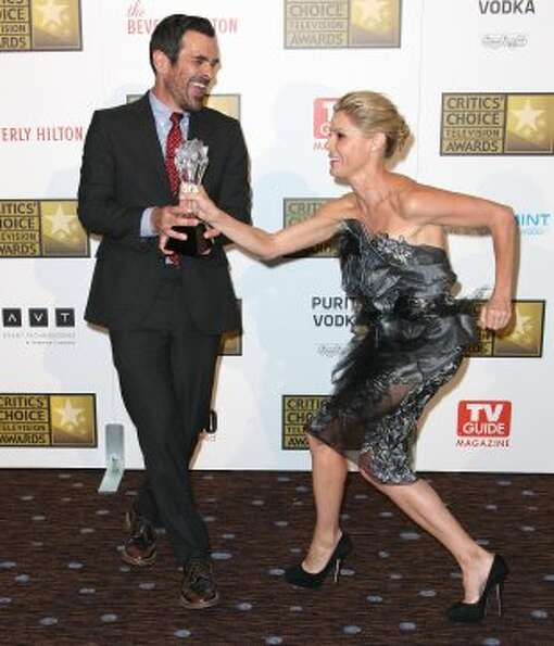 Ty Burrell (L) and Julie Bowen ham it up at the Critics' Choice Awards on June 18, 2012.  (Frederick