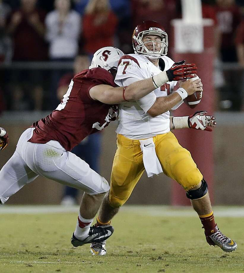 Trent Murphy wraps up USC quarterback Matt Barkley for a sack during the Trojans' unsuccessful last possession Sept. 15. Photo: Marcio Jose Sanchez, Associated Press