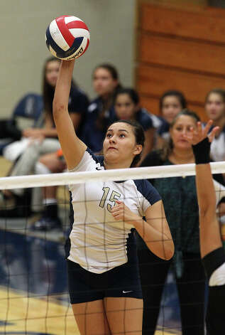 O'Connor's Brianna Sotello (15) attempts a kill against against Clark in high school volleyball at Taylor Fieldhouse on Wednesday, Sept. 26, 2012. Photo: Kin Man Hui, San Antonio Express-News / ©2012 San Antonio Express-News