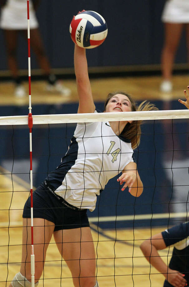 O'Connor's Kristin Fording (14) goes up for a shot against Clark in high school volleyball at Taylor Fieldhouse on Wednesday, Sept. 26, 2012. Photo: Kin Man Hui, San Antonio Express-News / ©2012 San Antonio Express-News