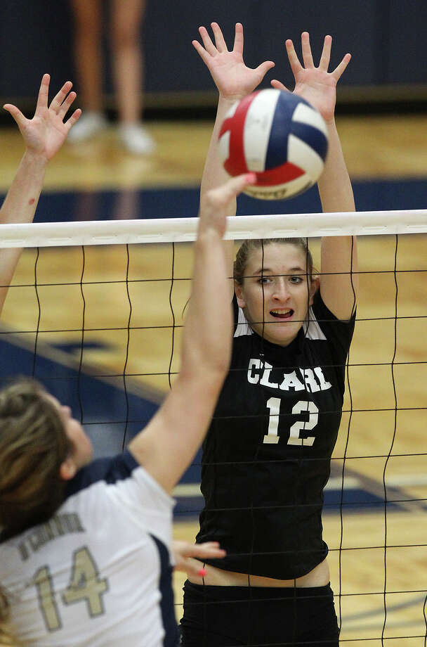 Clark's Kim Gillette (12) reaches for an attempted block against O'Connor's Kristin Fording (14) in high school volleyball at Taylor Fieldhouse on Wednesday, Sept. 26, 2012. Photo: Kin Man Hui, San Antonio Express-News / ©2012 San Antonio Express-News