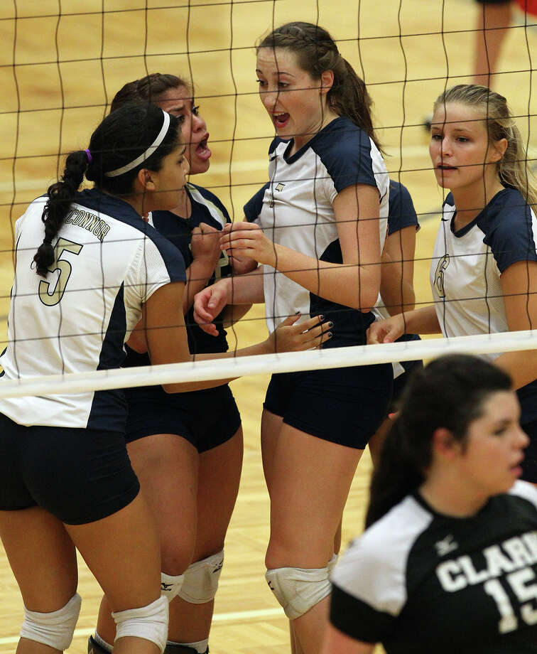 O'Connor players converge around teammate Laura Fox (center) after a blocked point against Clark in high school volleyball at Taylor Fieldhouse on Wednesday, Sept. 26, 2012. Photo: Kin Man Hui, San Antonio Express-News / ©2012 San Antonio Express-News