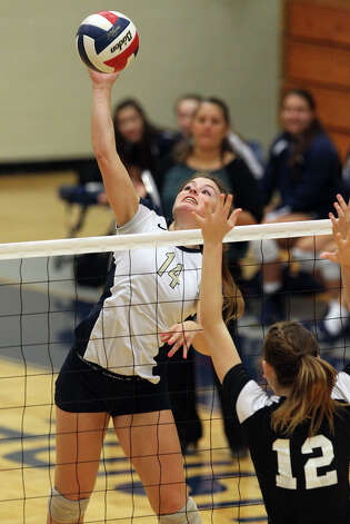 O'Connor's Kristin Fording (14) attempts a kill against Clark's Kim Gillette (12) in high school volleyball at Taylor Fieldhouse on Wednesday, Sept. 26, 2012. Photo: Kin Man Hui, San Antonio Express-News / ©2012 San Antonio Express-News