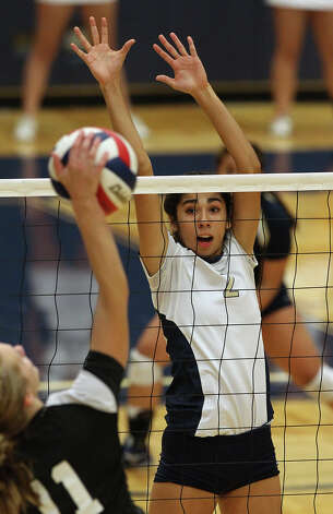 O'Connor's Alex Ecker (02) goes up to attempt a block against Clark's Katie Mattson (11) in high school volleyball at Taylor Fieldhouse on Wednesday, Sept. 26, 2012. Photo: Kin Man Hui, San Antonio Express-News / ©2012 San Antonio Express-News