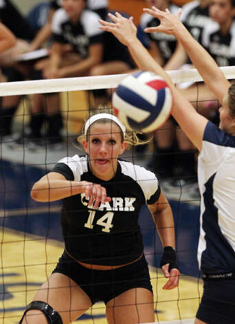Clark's Shelby MacKenzie (14) gets a kill against O'Connor in high school volleyball at Taylor Fieldhouse on Wednesday, Sept. 26, 2012. Photo: Kin Man Hui, San Antonio Express-News / ©2012 San Antonio Express-News