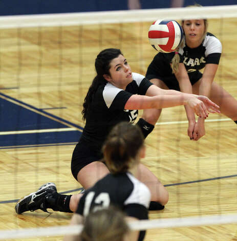 Clark's Carly Harr (15) and Meagan Moe (13) nearly collide to return a serve against O'Connor in high school volleyball at Taylor Fieldhouse on Wednesday, Sept. 26, 2012. Photo: Kin Man Hui, San Antonio Express-News / ©2012 San Antonio Express-News