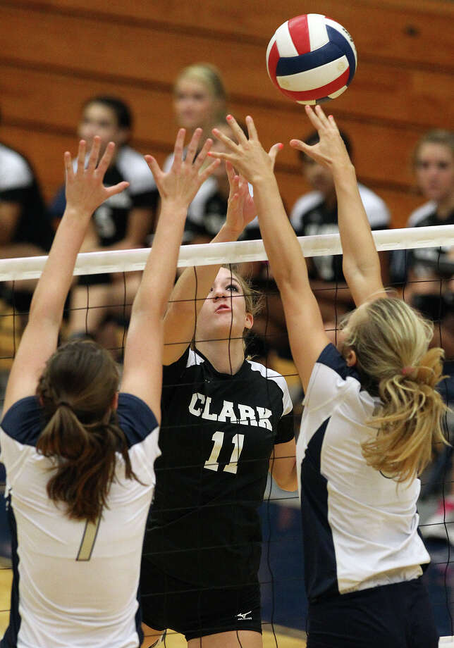 Clark's Katie Mattson (11) attempts to hit around O'Connor blocker's Laura Fox (07) and Brooke Burgess (06) in high school volleyball at Taylor Fieldhouse on Wednesday, Sept. 26, 2012. Photo: Kin Man Hui, San Antonio Express-News / ©2012 San Antonio Express-News