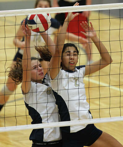 O'Connor's Kendall Groff (09) and Alex Ecker (02) collide while going for a block against Clark in high school volleyball at Taylor Fieldhouse on Wednesday, Sept. 26, 2012. Photo: Kin Man Hui, San Antonio Express-News / ©2012 San Antonio Express-News