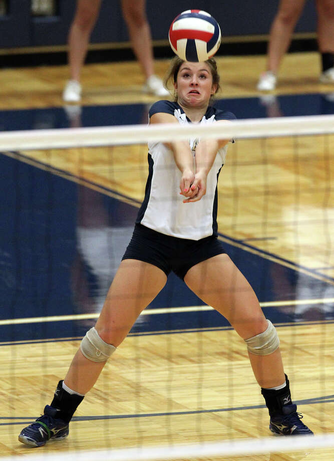 O'Connor's Kristin Fording (14) returns a serve against Clark in high school volleyball at Taylor Fieldhouse on Wednesday, Sept. 26, 2012. Photo: Kin Man Hui, San Antonio Express-News / ©2012 San Antonio Express-News