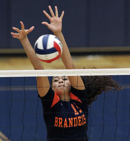 Brandeis' DeeDee Cardenas (13) makes a block against Warren in high school volleyball at Taylor Fieldhouse on Wednesday, Sept. 26, 2012. Photo: Kin Man Hui, San Antonio Express-News / ©2012 San Antonio Express-News