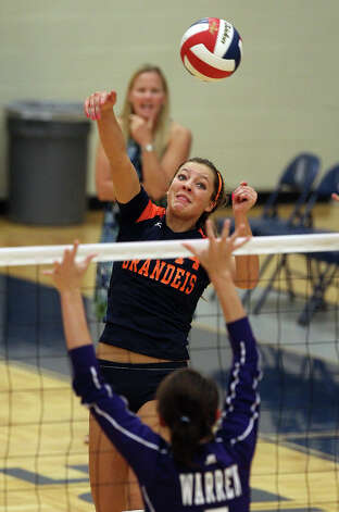 Brandeis' Joanna Neu (14) attempt a hit against Warren's Lauren McQueen (05) in high school volleyball at Taylor Fieldhouse on Wednesday, Sept. 26, 2012. Photo: Kin Man Hui, San Antonio Express-News / ©2012 San Antonio Express-News