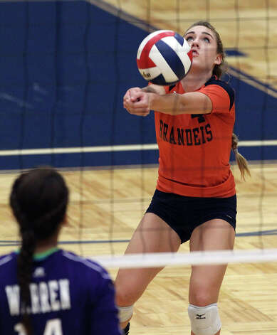 Brandeis' Cydney Denning (04) returns a serve against Warren in high school volleyball at Taylor Fieldhouse on Wednesday, Sept. 26, 2012. Photo: Kin Man Hui, San Antonio Express-News / ©2012 San Antonio Express-News