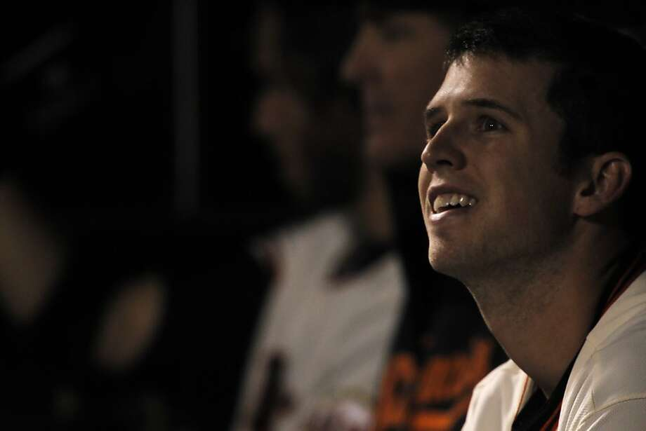 Buster Posey smiles in the dugout after his 100th rbi in the third inning. The San Francisco Giants played the Arizona Diamondbacks at AT&T Park in San Francisco, Calif., on Wednesday, September 26, 2012, defeating the Diamondbacks 6-0 Photo: Carlos Avila Gonzalez, The Chronicle