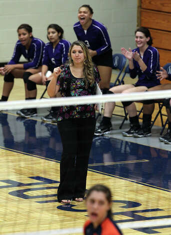 Warren volleyball coach Brandace Boren reacts to a point in a game against Brandeis at Taylor Fieldhouse on Wednesday, Sept. 26, 2012. Photo: Kin Man Hui, San Antonio Express-News / ©2012 San Antonio Express-News