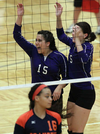 Warren's Shaina Garza (15) celebrates after she makes the winning point to take game 2 against Brandeis in high school volleyball at Taylor Fieldhouse on Wednesday, Sept. 26, 2012. Photo: Kin Man Hui, San Antonio Express-News / ©2012 San Antonio Express-News