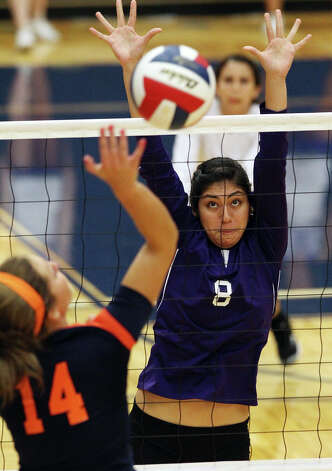 Warren's Lauren Bernal (08) attempts a block against Brandeis' Joanna Neu (14) in high school volleyball at Taylor Fieldhouse on Wednesday, Sept. 26, 2012. Photo: Kin Man Hui, San Antonio Express-News / ©2012 San Antonio Express-News