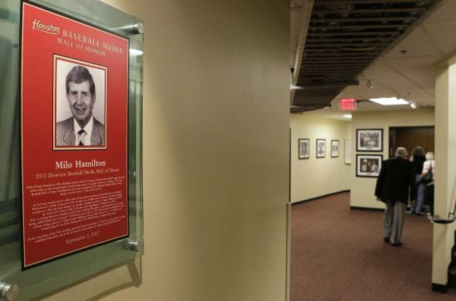 The Milo Hamilton Houston baseball media wall of honor plaque is shown on the wall as Milo leaves af