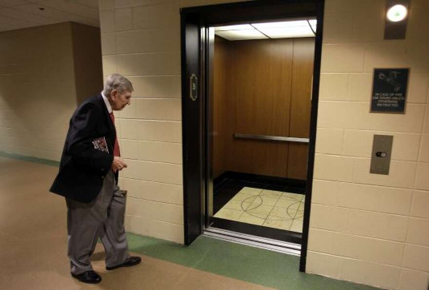 After arriving to Minute Maid Park, Milo Hamilton enters the elevator to go to his radio booth where