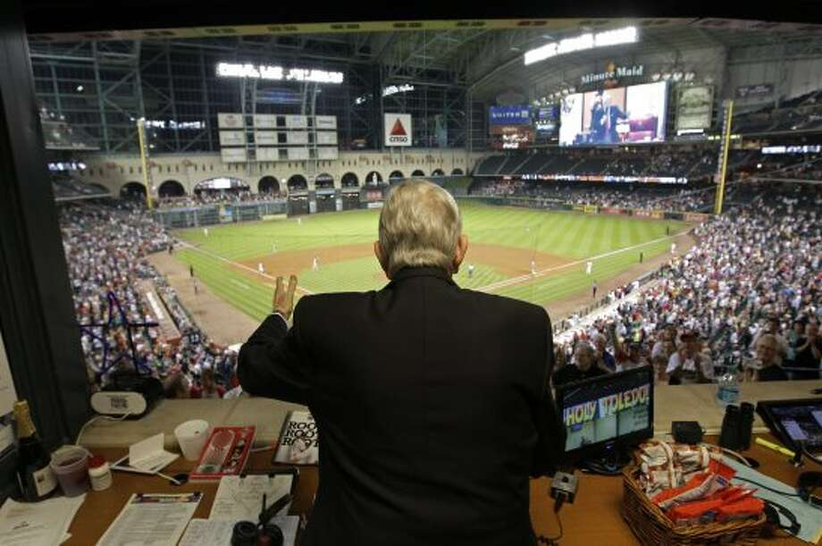 Milo Hamilton waves and addresses the crowd from the radio booth in the 7th inning as he calls the Houston Astros and St. Louis Cardinals game for his last home game as the radio voice of the Astros at Minute Maid Park Wednesday, Sept. 26, 2012, in Houston. ( Melissa Phillip / Houston Chronicle ) (Houston Chronicle)