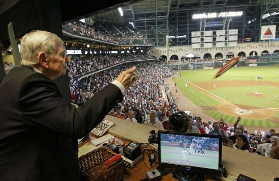 Milo Hamilton tosses bags of peanuts to the crowd from the radio booth in the 7th inning as he calls the Houston Astros and St. Louis Cardinals game for his last home game as the radio voice of the Astros at Minute Maid Park Wednesday, Sept. 26, 2012, in Houston. ( Melissa Phillip / Houston Chronicle ) (Houston Chronicle)