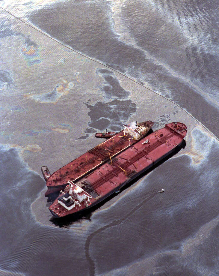 The Exxon Baton Rouge, top, off-loads crude oil from the Exxon Valdez after it ran aground in Prince William sound in Alaska, in this March 26, 1989 file photo. The Supreme Court, Monday, Oct. 2, 2000, refused to free Exxon Mobil Corp. from having to pay $5 billion in damages for the 1989 oil spill in Alaska, the nation's worst ever. (AP Photos/Stapleton, File)     HOUCHRON CAPTION (03/21/1999): Ten years ago Wednesday, the Exxon Valdez spilled 11 million gallons of oil into Alaska's Prince William Sound, resulting in the deaths of thousands of sea creatures and birds. The tanker is shown here with the smaller Exxon Baton Rouge attempting to off-load some of the crude on March 26, 1989. Photo: STAPLETON, AP / AP