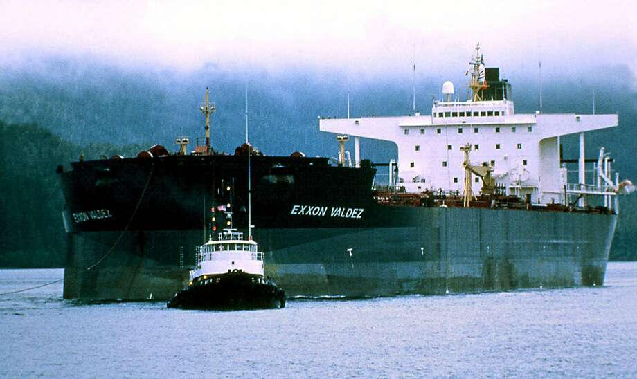 The Exxon Valdez sits on Bligh Reef in Prince William Sound, Alaska, after the giant tanker ran aground in March 1989, spilling 11 million gallons of crude oil. The tanker, whose name was changed to the SeaRiver Mediterranean, was barred by federal law from returning to Alaska. Photo: AL GRILLO, AP / AL GRILLO