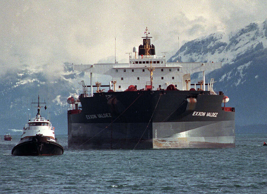 Tugboats pull the crippled tanker Exxon Valdez towards Naked Island in Prince William Sound, Alaska in this April 5, 1989 file photo. The Supreme Court on Monday, Oct. 29, 2007, agreed to decide whether Exxon Mobil Corp. should pay $2.5 billion in punitive damages in connection with the huge Exxon Valdez oil spill that fouled more than 1,200 miles of Alaskan coastline in 1989. Photo: Rob Stapleton, AP / AP
