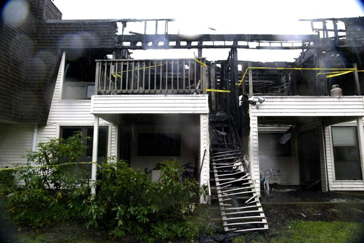 Rear exterior of the scene of an overnight fire at Quincy Condos on Hulls Highway in Fairfield on Wednesday, Dec. 9, 2009.