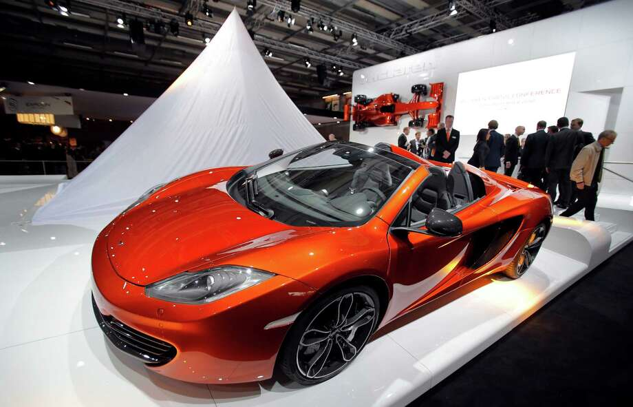 The new McLaren 12C Spider on display during the press day at the Paris Auto Show, France, Thursday, Sept. 27, 2012. The Paris Auto Show will open its gates to the public from Sept. 29 to Oct. 14. (AP Photo/Christophe Ena) Photo: Christophe Ena, Associated Press / AP