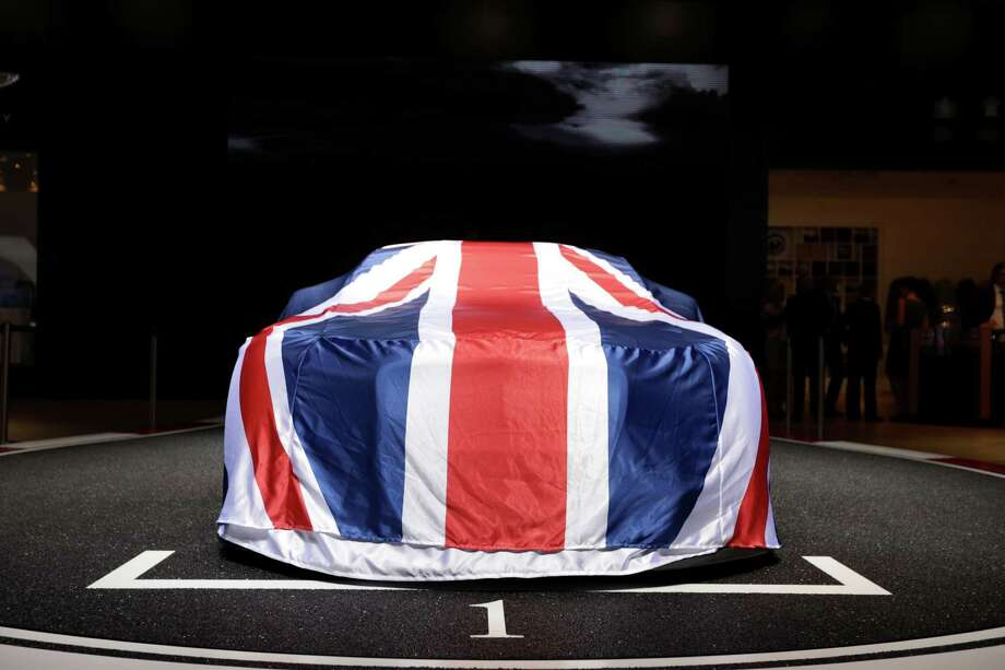 A British Union Jack protective cover sits on a automobile on the Bentley Motors Ltd. stand on the first day of the Paris Motor Show in Paris, France, on Thursday, Sept. 27, 2012. The Paris Motor Show will showcase the latest models from the auto industry's leading manufacturers at the Paris Expo exhibition centre this week. Photographer:  Photographer: Jason Alden/Bloomberg Photo: Jason Alden, Bloomberg / Copyright 2012 Bloomberg Finance LP