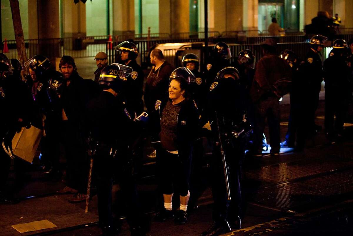 SFPD arrests protesters during an unannounced midnight raid on the Occupy encampment at 101 Market Street in San Francisco, Calif., Wednesday, September 26, 2012.