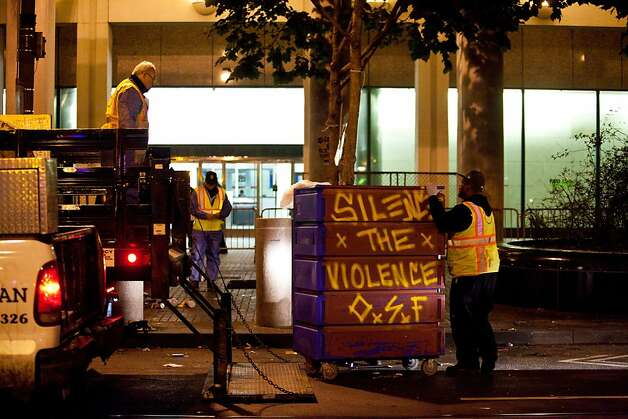 DPW cleans picks up the arressttees belongings during an unannounced midnight raid on the Occupy encampment at 101 Market Street in San Francisco, Calif., Wednesday, September 26, 2012. Photo: Jason Henry, Special To The Chronicle