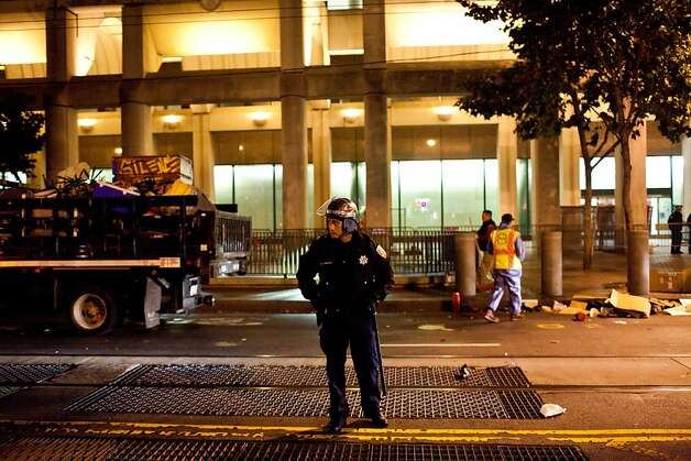 SFPD during an unannounced midnight raid on the Occupy encampment at 101 Market Street in San Francisco, Calif., Wednesday, September 26, 2012. Photo: Jason Henry, Special To The Chronicle