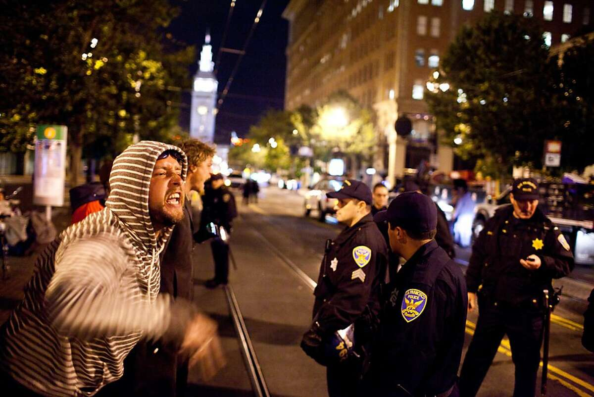 Jesse Hughes-MacArthur, 30 screams at SFPD officers during an unannounced midnight raid on the Occupy encampment at 101 Market Street in San Francisco, Calif., Wednesday, September 26, 2012.