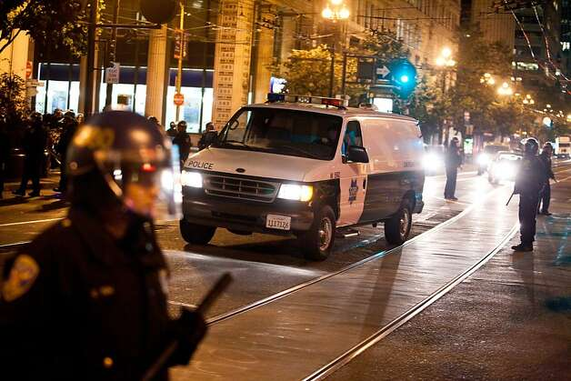 An SFPD van arrived during a unannounced midnight raid on the Occupy encampment at 101 Market Street in San Francisco, Calif., Wednesday, September 26, 2012. Photo: Jason Henry, Special To The Chronicle