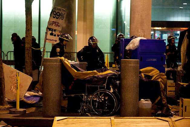 SFPD tear down tents during an unannounced midnight raid on the Occupy encampment at 101 Market Street in San Francisco, Calif., Wednesday, September 26, 2012. Photo: Jason Henry, Special To The Chronicle