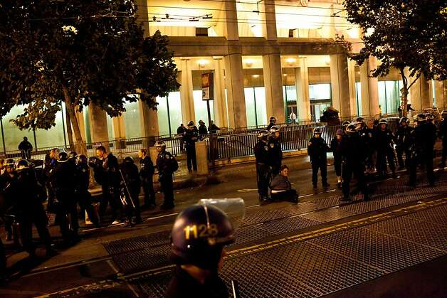 SFPD arrests occupiers during an unannounced midnight raid on the Occupy encampment at 101 Market Street in San Francisco, Calif., Wednesday, September 26, 2012. Photo: Jason Henry, Special To The Chronicle