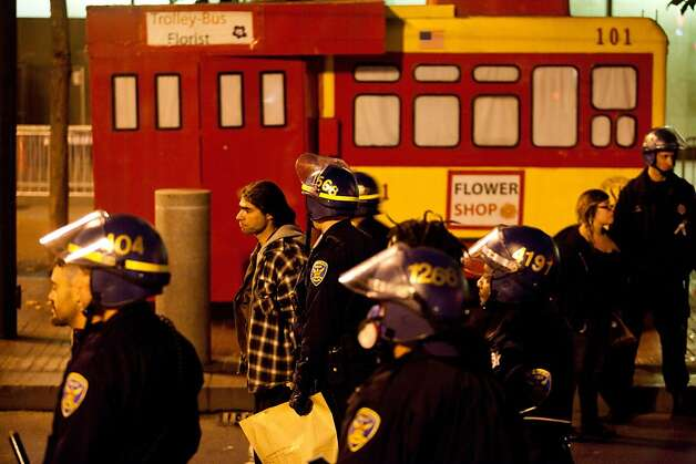 SFPD arrests protesters during an unannounced midnight raid on the Occupy encampment at 101 Market Street in San Francisco, Calif., Wednesday, September 26, 2012. Photo: Jason Henry, Special To The Chronicle