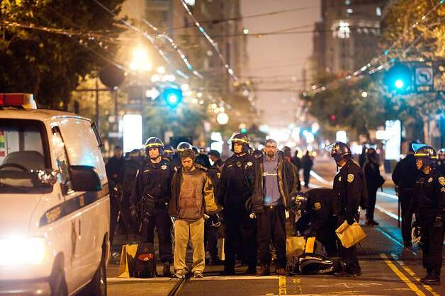 SFPD arrest protesters during an unannounced midnight raid on the Occupy encampment at 101 Market Street in San Francisco, Calif., Wednesday, September 26, 2012. Photo: Jason Henry, Special To The Chronicle