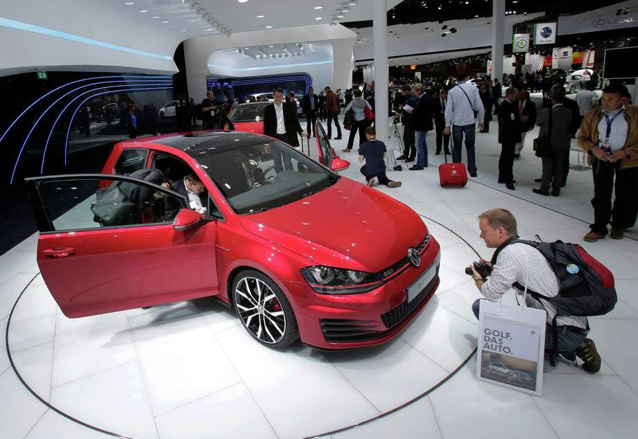 The new Volkswagen Golf GTI is on display during the press day at the Paris Auto Show, France, Thursday, Sept. 27, 2012. The Paris Auto Show will open its gates to the public from Sept. 29 to Oct. 14. (AP Photo/Michel Euler) Photo: Michel Euler, Associated Press / AP